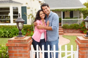 Hispanic couple outside home